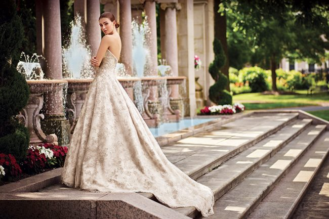 (David Tutera for Mon Cheri Style Gilda) The strapless embroidered metallic lace on tulle over satin elaborate creates a magnificent texture and opulence. Available in ivory and spun gold (shown) or white and silver. $1,099, Brides 2 Be by Hope Mitchell, Rehoboth, Del., www.brides2bebyhope.com
