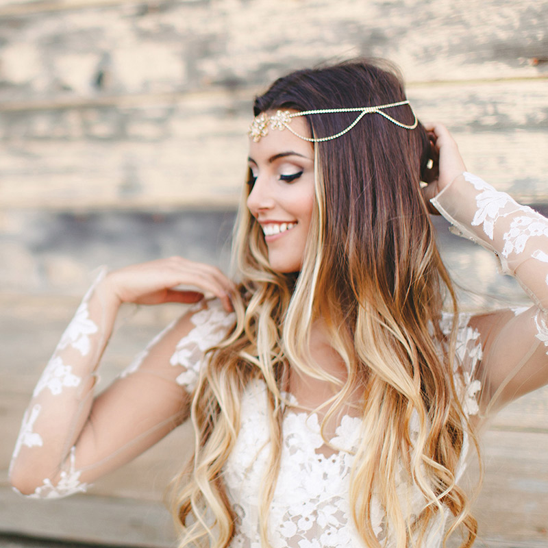 Try this boho-chic inspired look by adding a jeweled vintage head chain. Haute Bride Style HB116, $395, Jennifer's Bridal, Hockessin, Del.