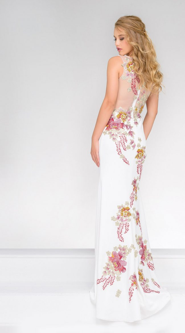 . (Jovani Style 33679) Beautiful embroidered jersey dress with intricate work. This ivory floral dress features a high neckline, an embroidered floral design accessorized with rhinestones, a sheer back and short train. $560, Occasions Boutique, Malvern, Pa., www.occasions-boutique.com