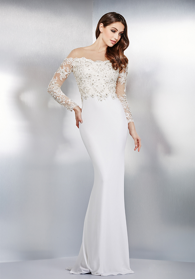Jovani Style 31125 | Breathtaking ivory fitted dress features a lace bodice, long sleeves and sheer illusion off the shoulder neckline. $560, Occasions Boutique, Malvern, Pa., www.occasions-boutique.com