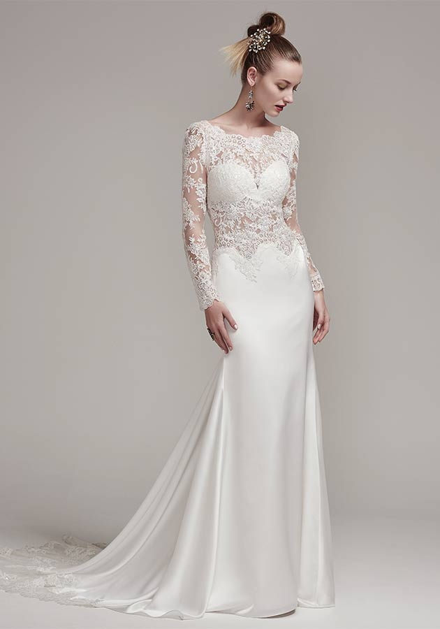 Sottero and Midgley – Fiona Rose | An illusion lace crop top is accented with a stunning scalloped lace bateau neckline and long sleeves. The matching Orlando satin sheath skirt with lace trim creates a fashion-forward two-piece wedding dress style. $1,429, Brides 2 Be by Hope Mitchell, Rehoboth, Del., www.brides2bebyhope.com