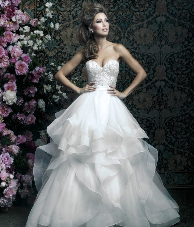 Allure Couture Style C417 | Sweeping ruffles add volume and texture to this anything-but-ordinary strapless ball gown. $1,685, Claire's Fashions, Wilmington, Del., www.clairesfashions.net