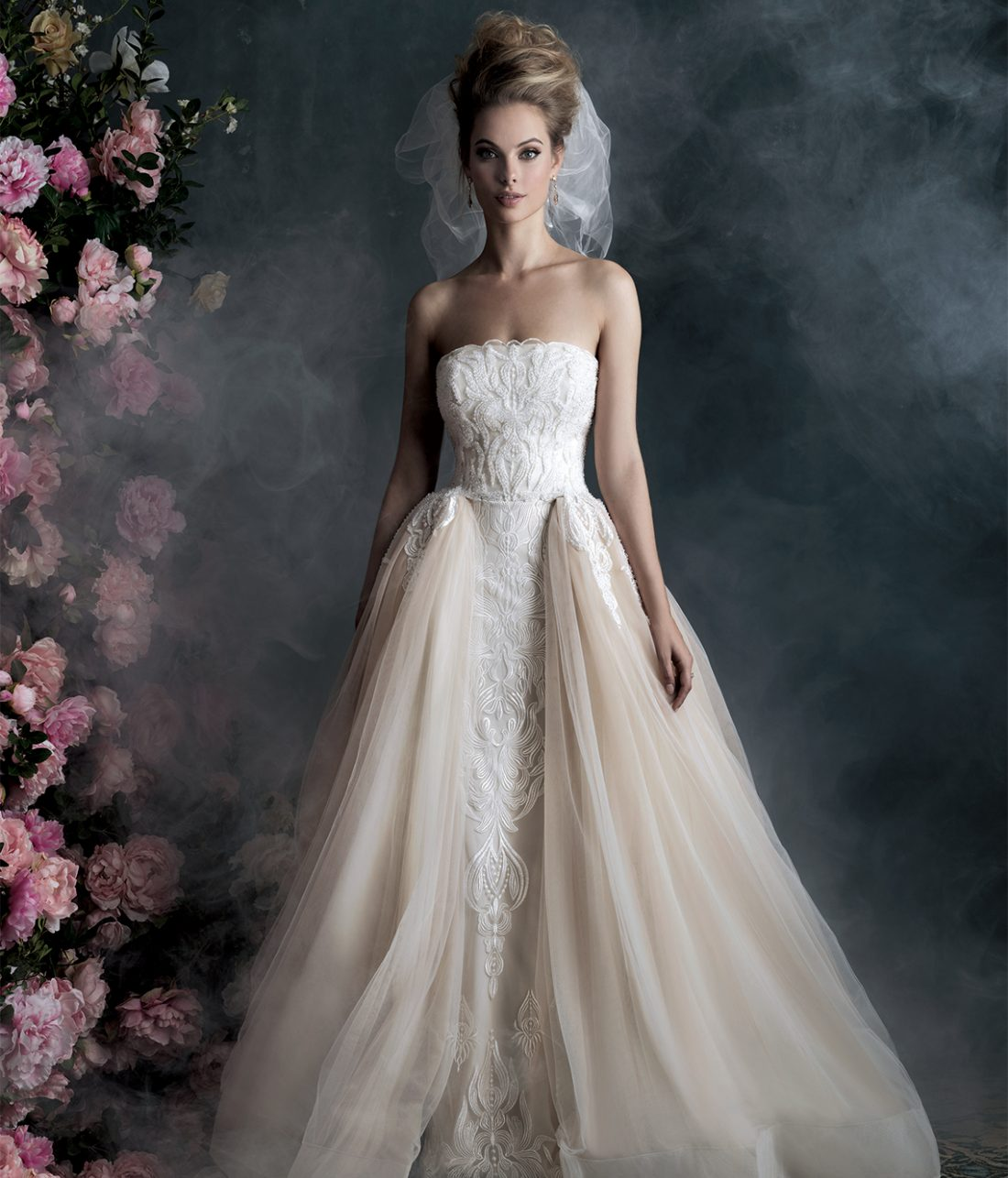 Allure Couture Style C400 | The elegant sweep of this layered ball gown is richened by delicate embroidery. $3,260, Claire's Fashions, Wilmington, Del., www.clairesfashions.net