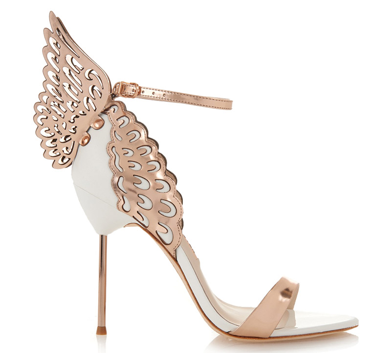 Evangeline Angel Wing Sandal By Sophia Webster | This rose gold and white shoe needs no introduction. It is perfect for the bride who wants something whimsical, avant-garde and extremely sexy. $560, www.neimanmarcus.com, Neiman Marcus, King of Prussia Mall, 170 N. Gulph Road, King of Prussia, (610) 962-6200.
