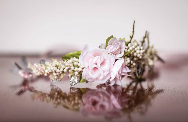 This crown is perfect for a summer wedding. The beads and satin glimmer against the blush rosette. Wedding Crown, $34, Little Lady Accessory, Smyrna, Del.
