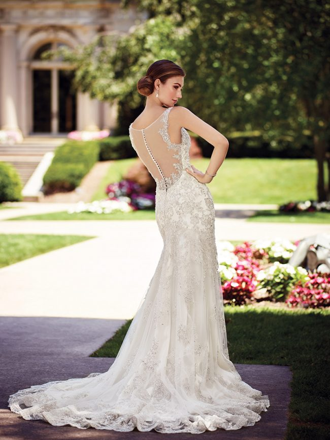 (David Tutera for Mon Cheri Style Chrisann) This satin sheath features scalloped lace straps, a plunging V-neckline, a beaded lace bodice with dropped waist, scalloped a hemline and chapel length train. $1,798, Brides 2 Be by Hope Mitchell Rehoboth, Del., www.brides2bebyhope.com