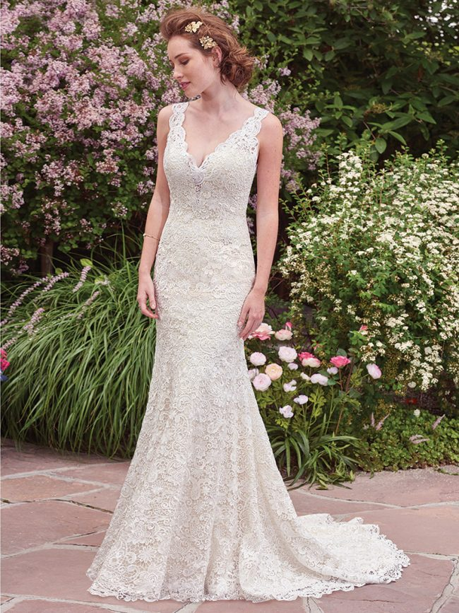 (Rebecca Ingram by Maggie Sottero Style Hope) This vintage-inspired gown boasts a subtle allover-lace fit-and-flare fit and features an illusion plunging neckline and scalloped edging. $899, Brides 2 Be by Hope Mitchell Rehoboth, Del., www.brides2bebyhope.com