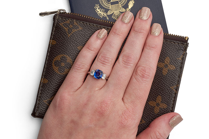 3-carat, cushion-cut, platinum sapphire and diamond ring. Colors range from Ceylon blue to violet, set with a matched pair of cushion-cut diamonds that are just shy of 1 carat. $27,500, by Suna Bros., Walter J. Cook Jeweler, Paoli, Pa., www.walterjcookjeweler.com  Polish: OPI Do You Take Lei Away? with Kiara Sky, N521 Sunset Blvd.