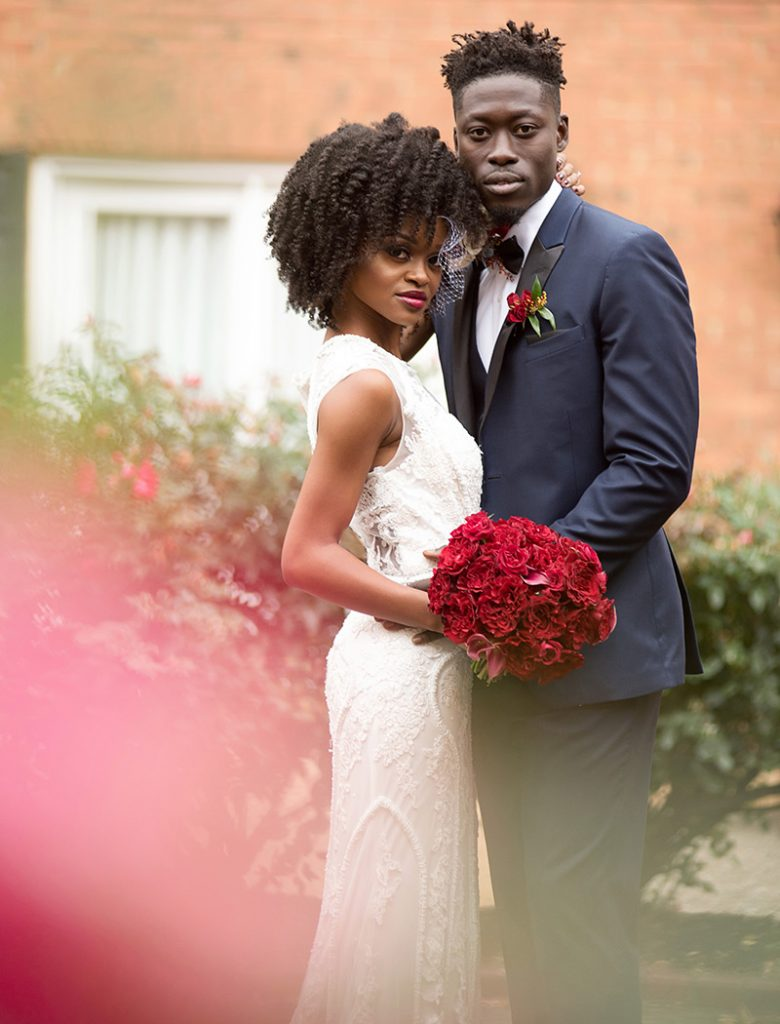 Bride and groom with red and navy wedding color scheme.